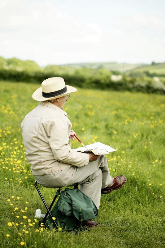 Senior Man Sitting On The Chair Drawing Photo - Pixlr Market