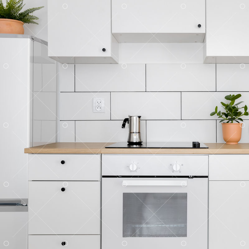 Contemporary Kitchen With White Tiles Wooden Worktop And Induction Hob Image Stock By Pixlr