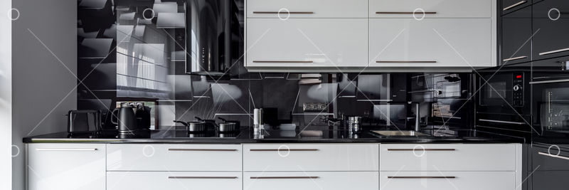 New Design Kitchen With White Cupboards And Black Wall Tiles Panorama Image Stock By Pixlr