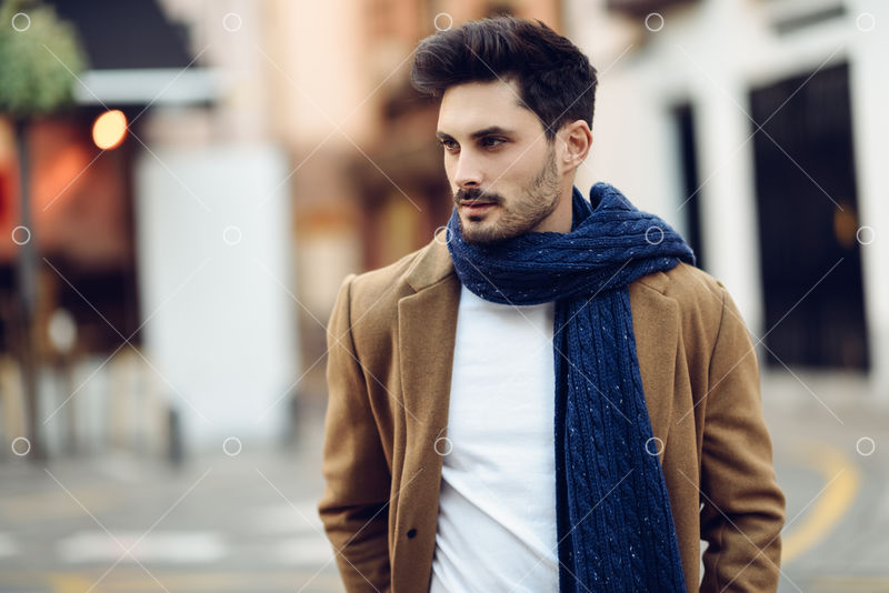 Young Man Wearing Winter Clothes In The Street Young Bearded Guy With Modern Hairstyle With Coat Scarf Blue Jeans And T Shirt Image Stock By Pixlr
