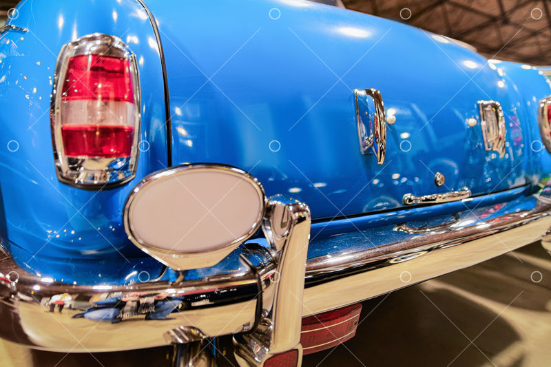 Back headlight of blue vintage classic car in Berlin in Germany. Details of  auto Image - Stock by Pixlr
