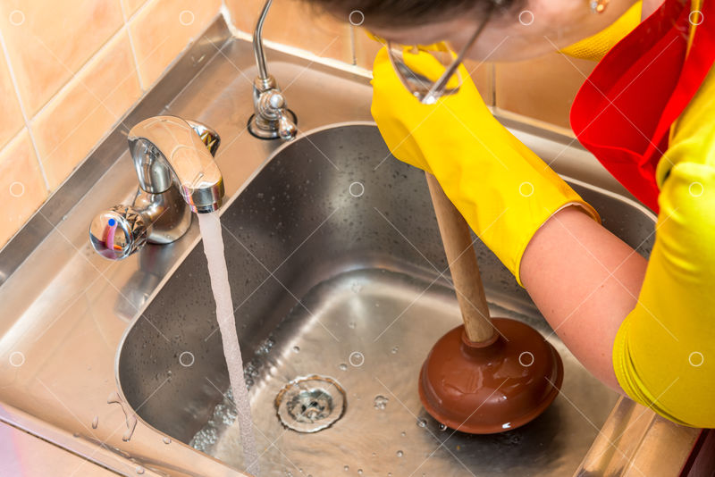 Cleaning Clogged Pipes In The Kitchen Sink With A Plunger Image Stock By Pixlr
